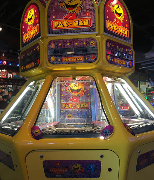 Pac-Man themed coin pusher.